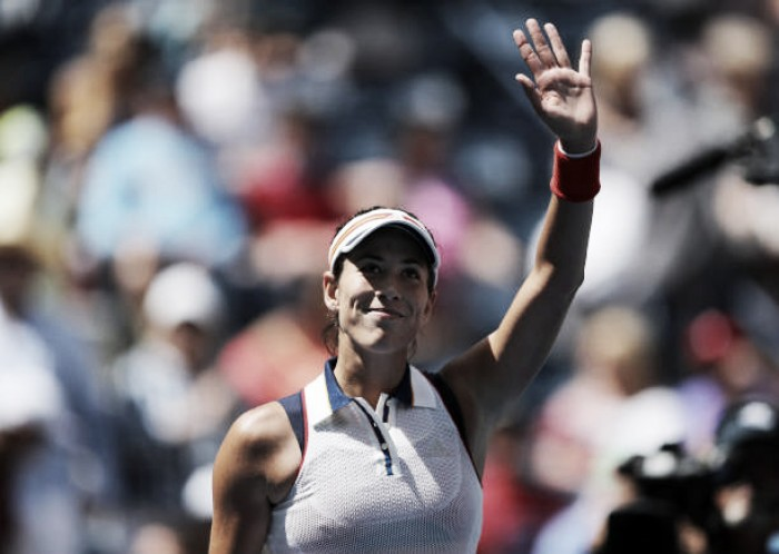 US Open: Garbine Muguruza eases into round two