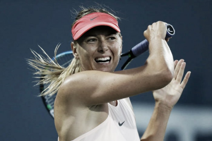 Arm injury ends Sharapova's return in Stanford