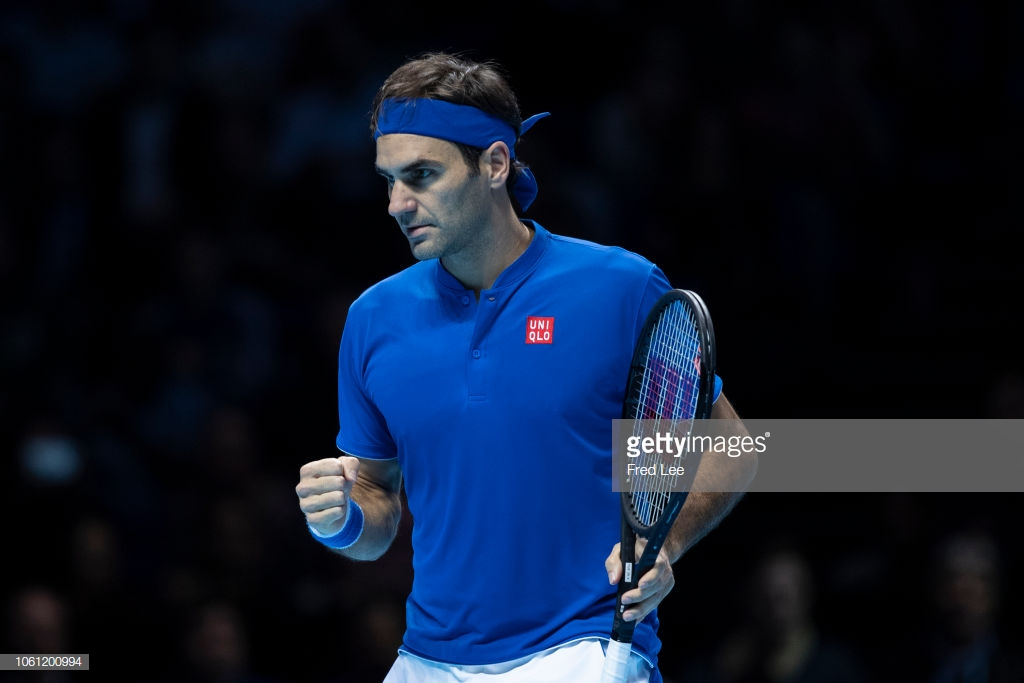ATP Finals: Roger Federer keeps semi-final hopes alive with easy win over Dominic Thiem
