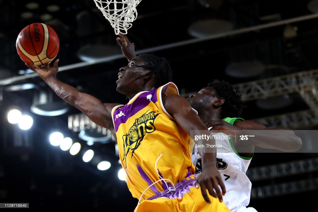 Jonathan James of London Lions is challenged at the rim by Roosevelt Davis of Mamchester Giants during the BBL Trophy Semi final 2nd leg match between London Lions and  Manchester Giants at Cooper box arena on Feb 14th 2019.