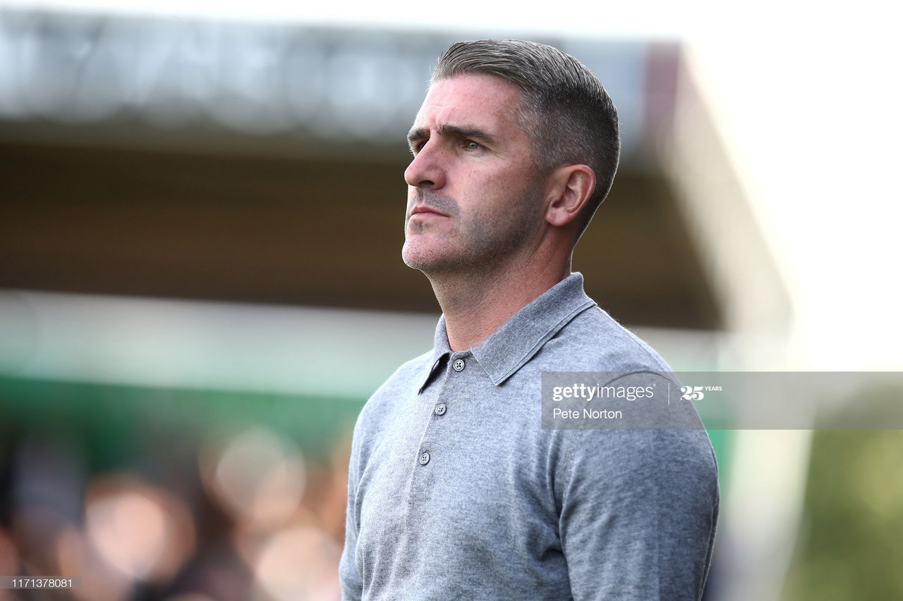 Pilgrims' Boss Ryan Lowe overlooking his side / Photo by Pete Norton/Getty Images