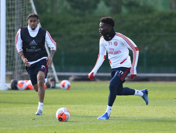 ST ALBANS, ENGLAND - MARCH 06: (L-R) Reiss Nelson and Bukayo Saka of Arsenal during a training session at London Colney on March 06, 2020 in St Albans, England. (Photo by Stuart MacFarlane/Arsenal FC via Getty Images)