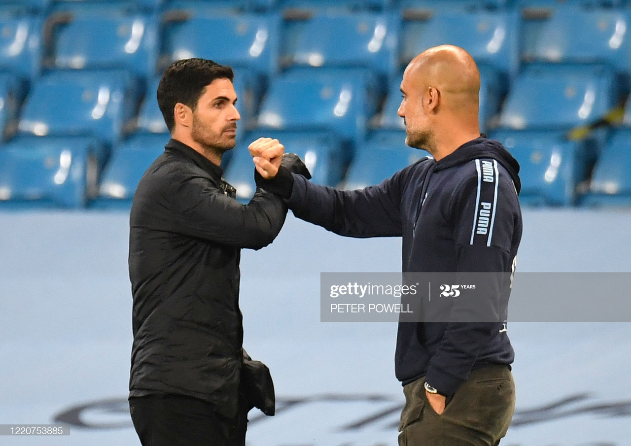 Arsenal's Spanish head coach Mikel Arteta (L) bumps arms with Manchester City's Spanish manager Pep Guardiola (R) at the end of the match during the English Premier League football match between Manchester City and Arsenal at the Etihad Stadium in Manchester, north west England, on June 17, 2020. - The Premier League makes its eagerly anticipated return today after 100 days in lockdown but behind closed doors due to coronavirus restrictions. (Photo by PETER POWELL / POOL / AFP)