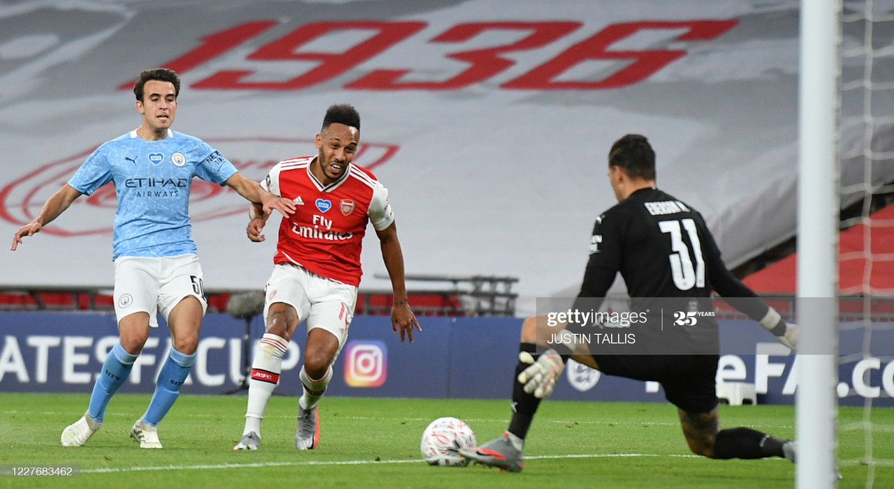 Arsenal's Gabonese striker Pierre-Emerick Aubameyang (C) scores their second goal during the English FA Cup semi-final football match between Arsenal and Manchester City at Wembley Stadium in London, on July 18, 2020. (Photo by JUSTIN TALLIS / POOL / AFP) / NOT FOR MARKETING OR ADVERTISING USE / RESTRICTED TO EDITORIAL USE (Photo by JUSTIN TALLIS/POOL/AFP via Getty Images)