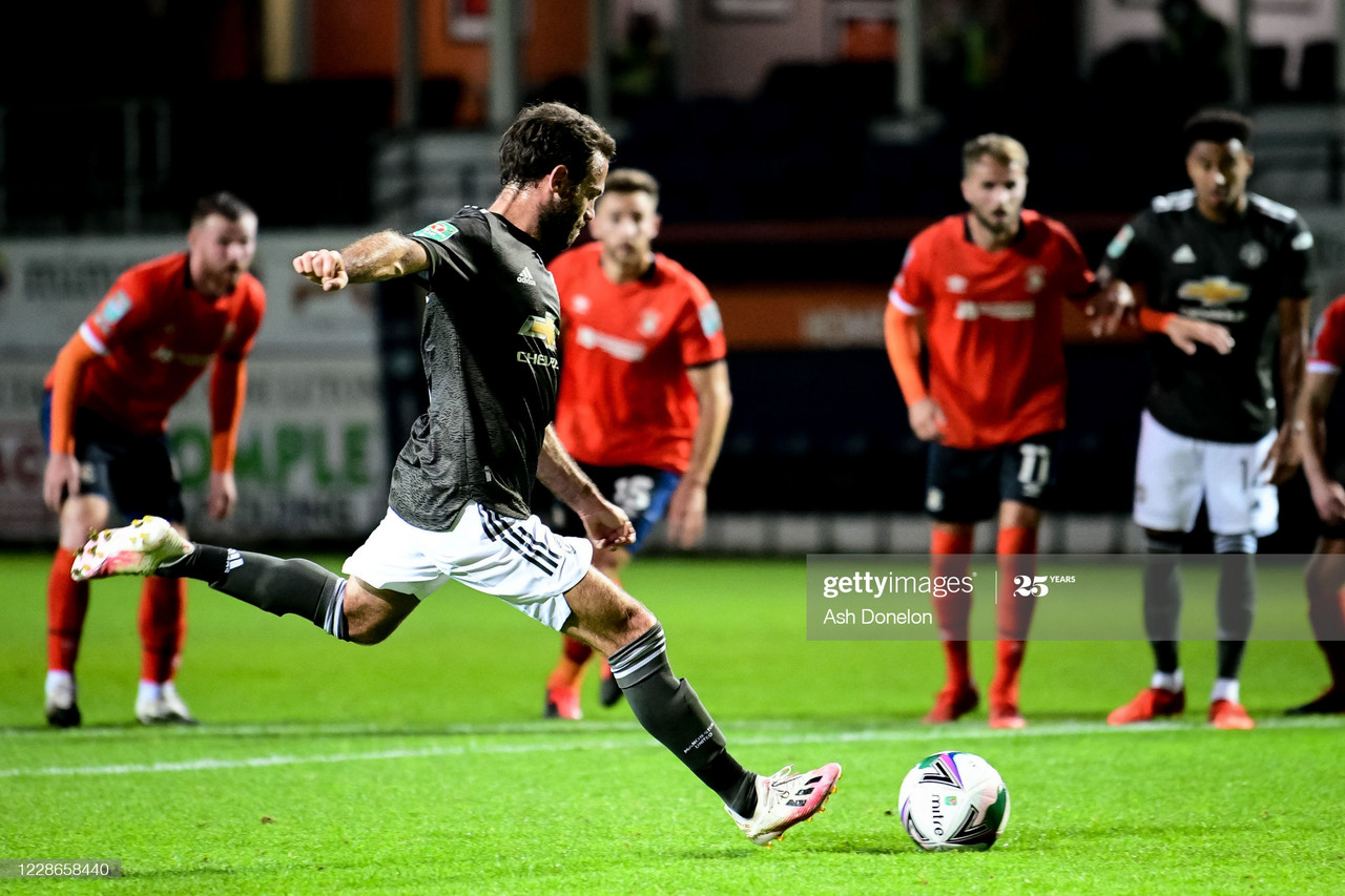 LUTON, ENGLAND - SEPTEMBER 22: Juan Mata of Manchester United scores a penalty to make the score 0-1 during the Carabao Cup Third Round match between Luton Town and Manchester United at Kenilworth Road on September 22, 2020 in Luton, England. (Photo by Ash Donelon/Manchester United via Getty Images)