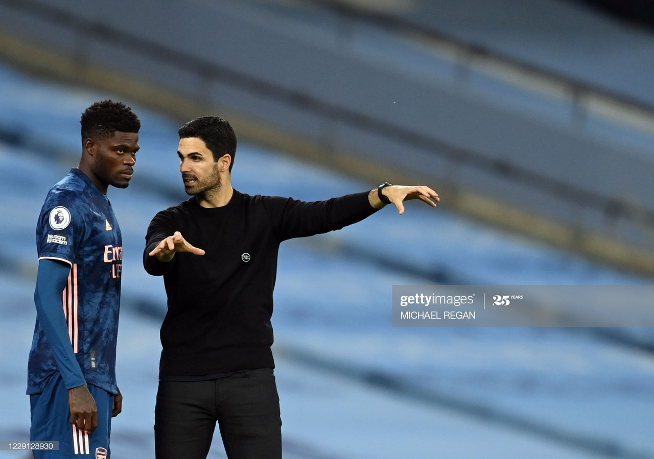 Arsenal's Ghanaian midfielder Thomas Partey (L) receives directions from Arsenal's Spanish manager Mikel Arteta during the English Premier League football match between Manchester City and Arsenal at the Etihad Stadium in Manchester, north west England, on October 17, 2020. (Photo by Michael Regan / POOL / AFP) / RESTRICTED TO EDITORIAL USE