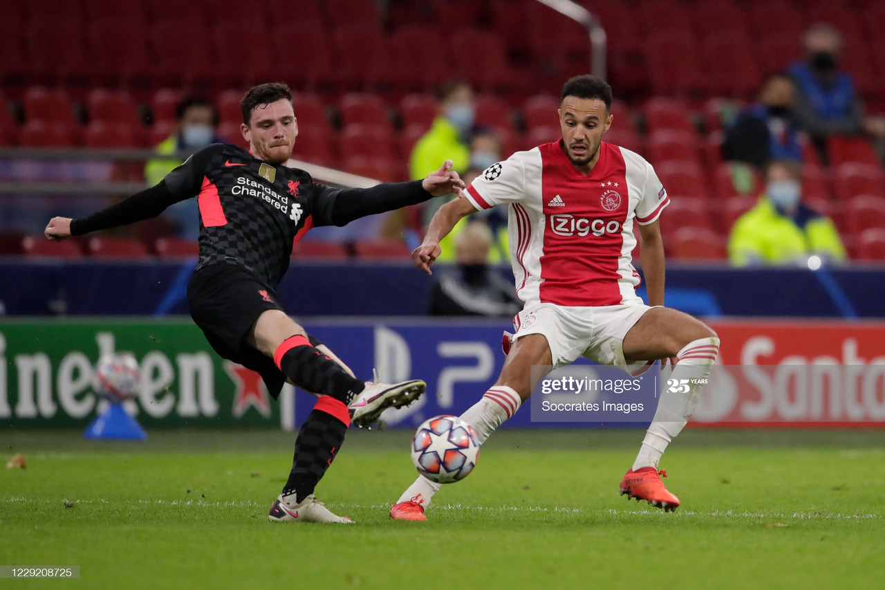 AMSTERDAM, NETHERLANDS - OCTOBER 21: (L-R) Andy Robertson of Liverpool, Noussair Mazraoui of Ajax during the UEFA Champions League match between Ajax v Liverpool at the Johan Cruijff Arena on October 21, 2020 in Amsterdam Netherlands (Photo by Rico Brouwer/Soccrates/Getty Images)