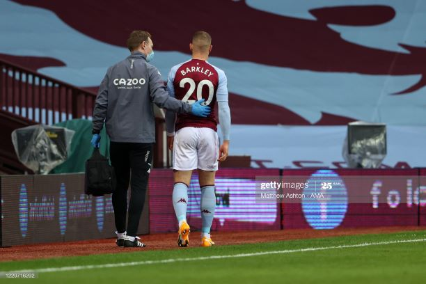 BIRMINGHAM, ENGLAND - NOVEMBER 21: Ross Barkley of Aston Villa leaves the game in the first half with an injury during the Premier League match between Aston Villa and Brighton & Hove Albion at Villa Park on November 21, 2020 in Birmingham, United Kingdom. Sporting stadiums around the UK remain under strict restrictions due to the Coronavirus Pandemic as Government social distancing laws prohibit fans inside venues resulting in games being played behind closed doors. (Photo by Matthew Ashton - AMA/Getty Images)