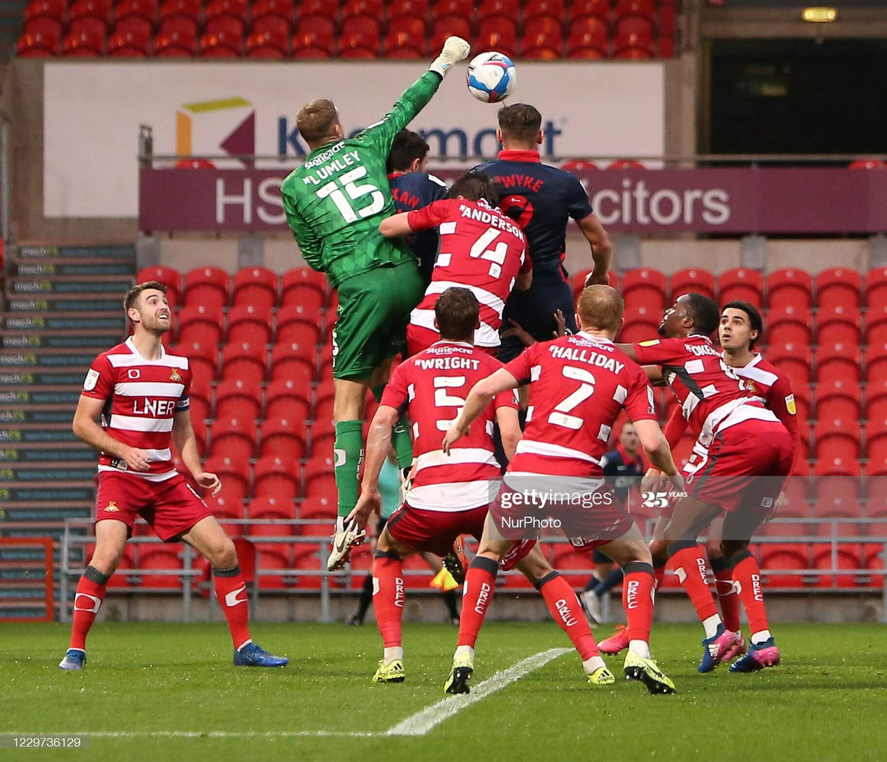Joe Lumley misses a chance to punch clear as Charlie Wyke heads wide in the first half during the Sky Bet League 1 match between Doncaster Rovers and Sunderland at the Keepmoat Stadium, Doncaster on Saturday 21st November 2020. (Photo by Michael Driver/MI News/NurPhoto via Getty Images)