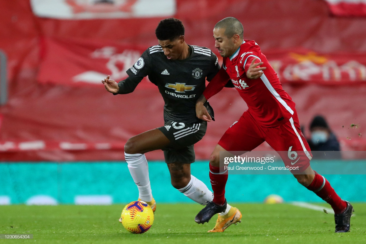 LIVERPOOL, ENGLAND - JANUARY 17: Manchester United's Marcus Rashford and Liverpool's Thiago Alcantara during the Premier League match between Liverpool and Manchester United at Anfield on January 17, 2021 in Liverpool, United Kingdom. (Photo by Paul Greenwood - CameraSport via Getty Images)