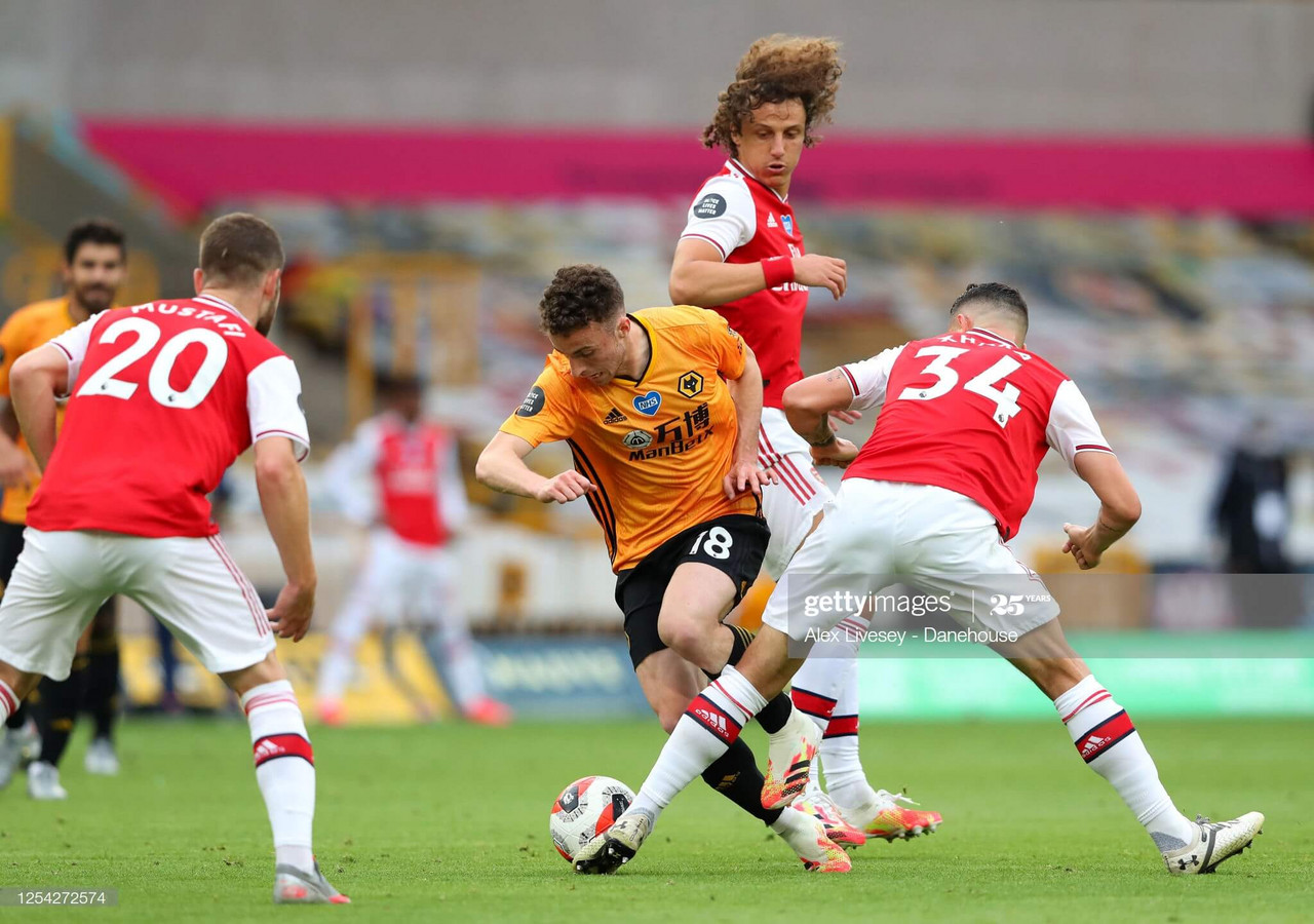 Wolves 0-2 Arsenal: Saka's superb strike seals victory for determined Gunners