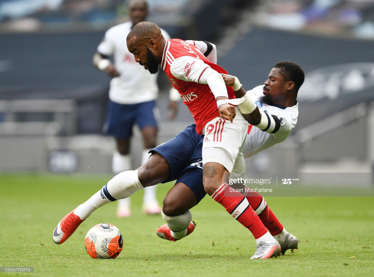 LONDON, ENGLAND - JULY 12: Alex Lacazette of Arsenal fouled by Serge Aurier of Tottenham during the Premier League match between Tottenham Hotspur and Arsenal FC at Tottenham Hotspur Stadium on July 12, 2020 in London, England. (Photo by Stuart MacFarlane/Arsenal FC via Getty Images