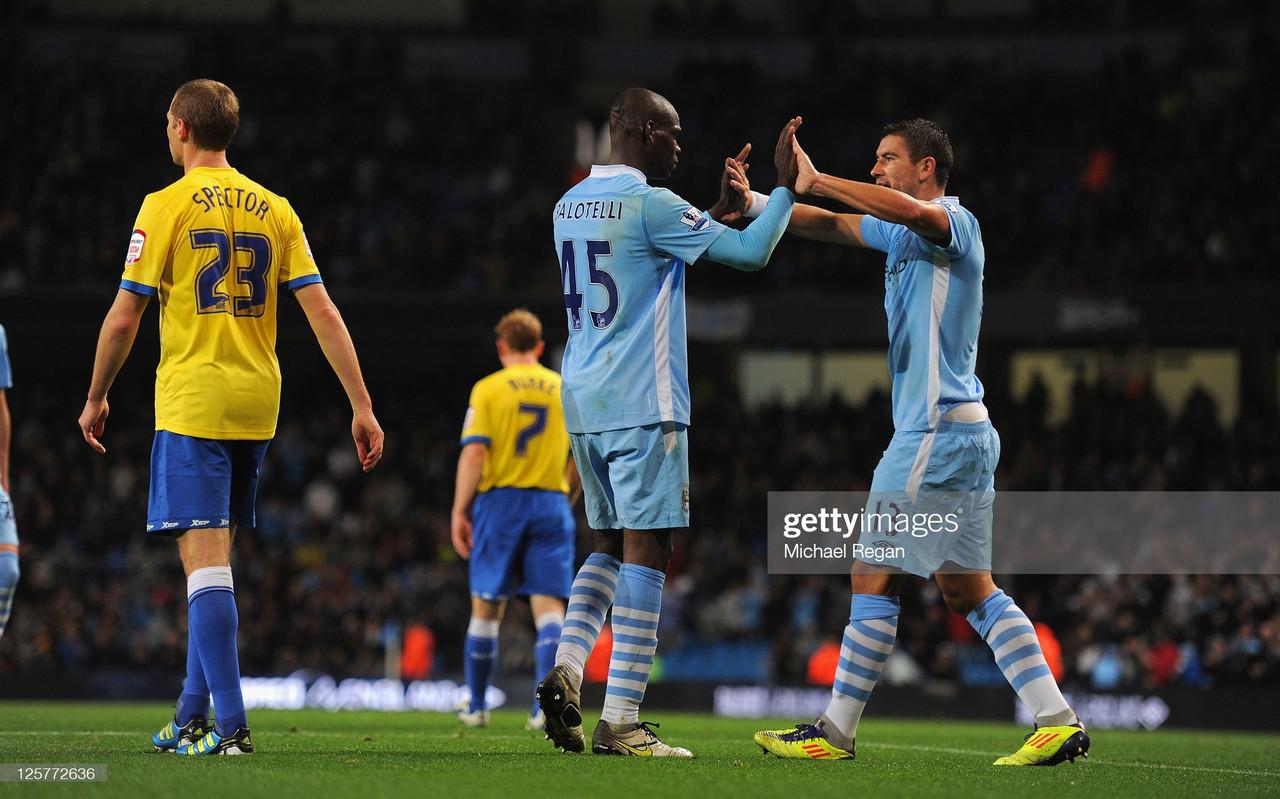 Mario Balotelli and Aleksandar Kolarov celebrate as Manchester City beat Birmingham City in 2011 | Michael Regan/Getty Images