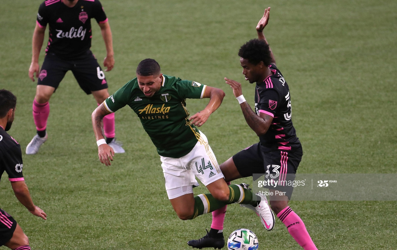 <div>Above: Seattle and Portland clash earlier in the season</div><span>(Photo by Abbie Parr/Getty Images)</span>