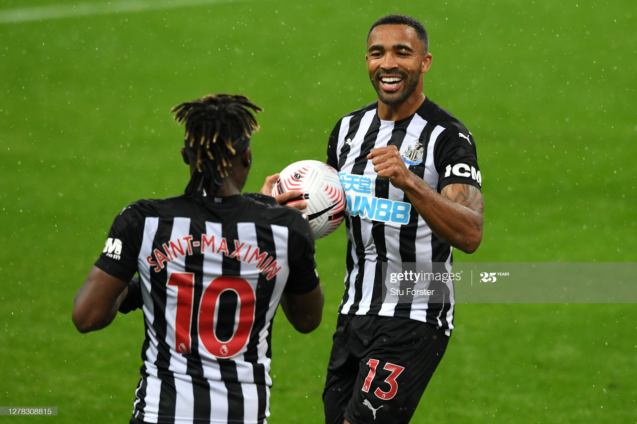 NEWCASTLE UPON TYNE, ENGLAND - OCTOBER 03: Callum Wilson of Newcastle United celebrates with teammate Allan Saint-Maximin after scoring his team's second goal during the Premier League match between Newcastle United and Burnley at St. James Park on October 03, 2020 in Newcastle upon Tyne, England. Sporting stadiums around the UK remain under strict restrictions due to the Coronavirus Pandemic as Government social distancing laws prohibit fans inside venues resulting in games being played behind closed doors. (Photo by Stu Forster/Getty Images)