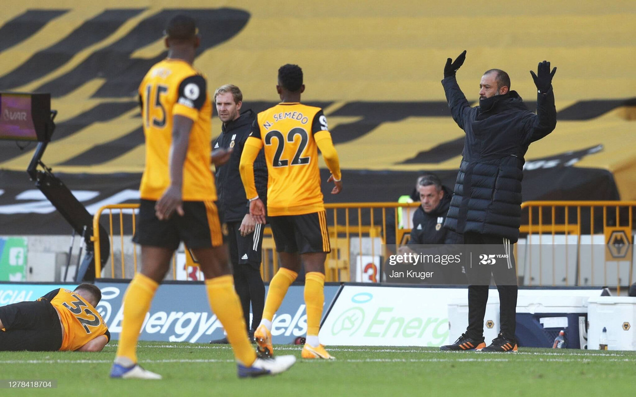Nuno Espirito Santo the head coach/manager of Wolverhampton Wanderers and Max Kilman of Wolverhampton Wanderers at full time during the Premier League match between Wolverhampton Wanderers and Fulham at Molineux on October 4, 2020, in Wolverhampton, United Kingdom. (Photo by James Williamson - AMA/Getty Images)