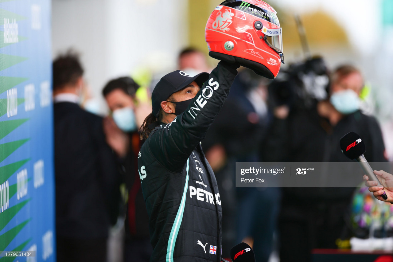 NUERBURG, GERMANY - OCTOBER 11: Lewis Hamilton of Mercedes and Great Britain with Michael Schumacher's helmet to celebrate equalling his record of 91 wins during the F1 Eifel Grand Prix at Nuerburgring on October 11, 2020 in Nuerburg, Germany. (Photo by Peter Fox/Getty Images)