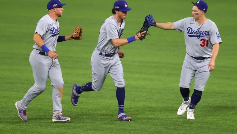 Matt Beaty (l.), Cody Bellinger (c.) and Joc Pederson (r.) celebrate after winning Game 3/Photo: Ronald Martinez