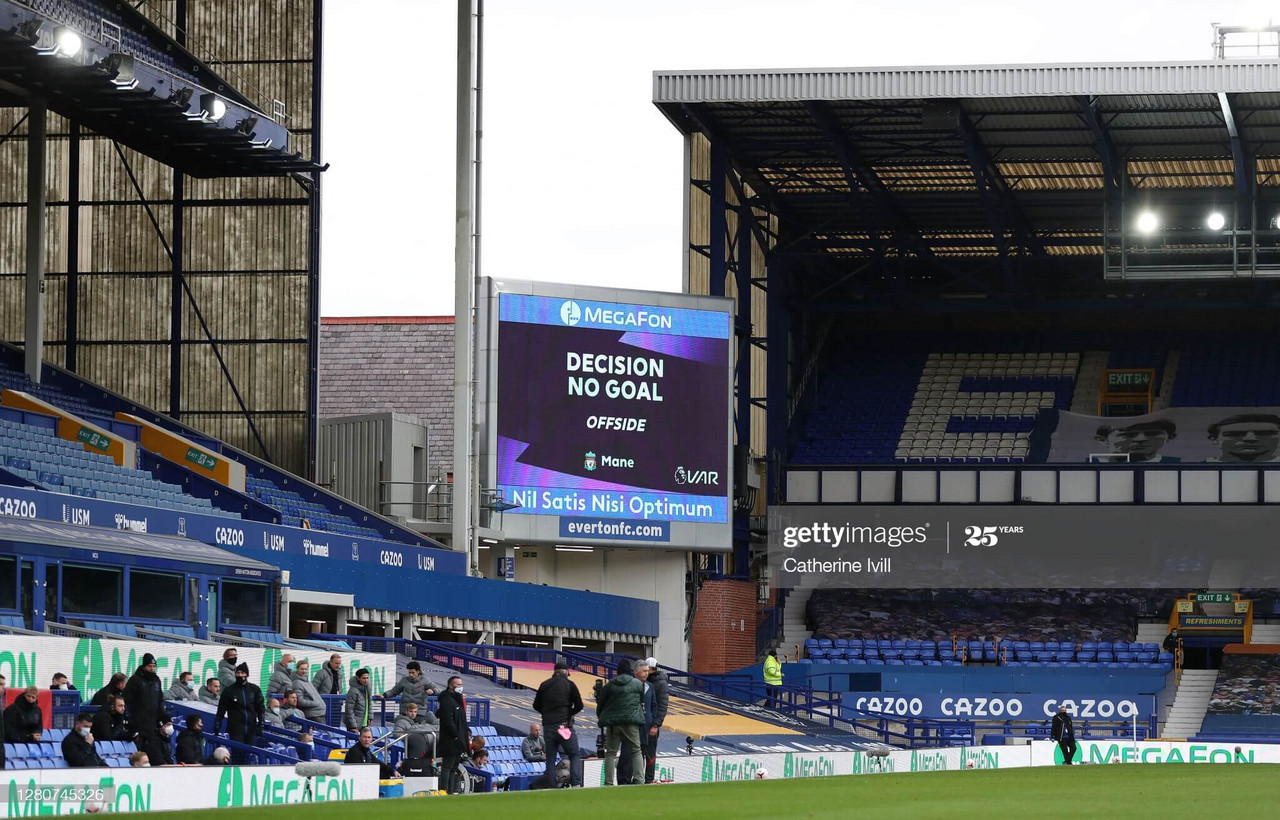 LIVERPOOL, ENGLAND - OCTOBER 17: The decision to rule out a goal for offside following a VAR review is displayed on a screen inside the stadium during the Premier League match between Everton and Liverpool at Goodison Park on October 17, 2020 in Liverpool, England. Sporting stadiums around the UK remain under strict restrictions due to the Coronavirus Pandemic as Government social distancing laws prohibit fans inside venues resulting in games being played behind closed doors. (Photo by Catherine Ivill/Getty Images)