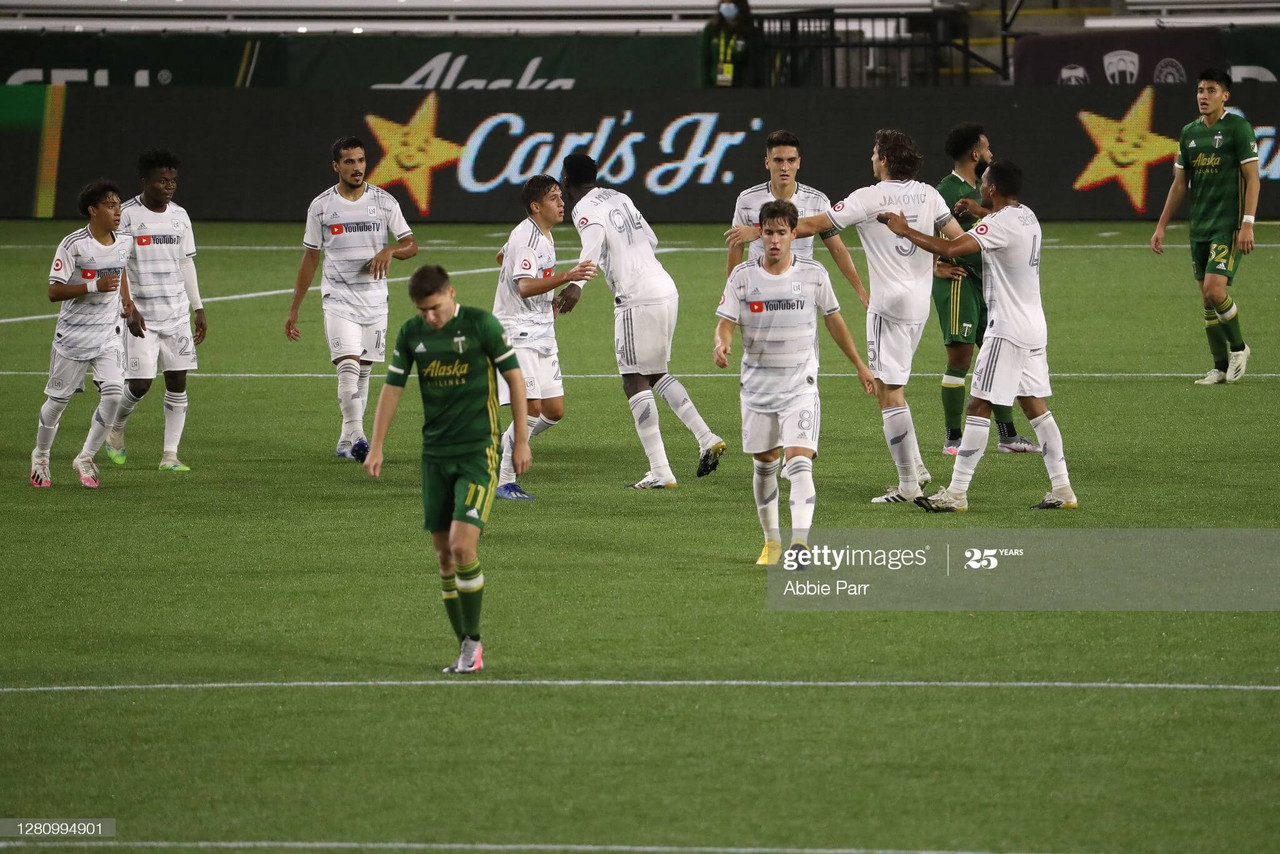PORTLAND, OREGON - OCTOBER 18: Los Angeles FC celebrates a goal by Christian Torres #21 of Los Angeles FC to tie the game 1-1 in the 93rd minute against the Portland Timbers at Providence Park on October 18, 2020 in Portland, Oregon. (Photo by Abbie Parr/Getty Images)
