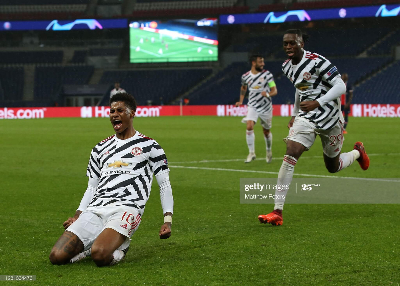 PARIS, FRANCE - OCTOBER 20: Marcus Rashford of Manchester United celebrates scoring their second goal during the UEFA Champions League Group H stage match between Paris Saint-Germain and Manchester United at Parc des Princes on October 20, 2020 in Paris, France. (Photo by Matthew Peters/Manchester United via Getty Images)