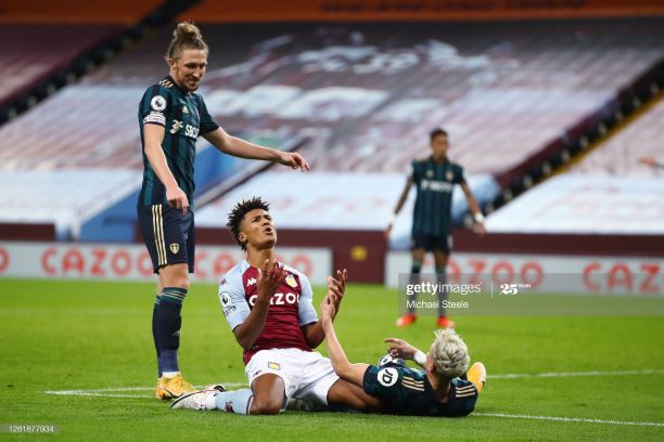 Ollie Watkins of Aston Villa reacts after a missed chance as Luke Ayling of Leeds United looks on during the Premier League match between Aston Villa and Leeds United at Villa Park on October 23, 2020 in Birmingham, England. Sporting stadiums around the UK remain under strict restrictions due to the Coronavirus Pandemic as Government social distancing laws prohibit fans inside venues resulting in games being played behind closed doors. (Photo by Michael Steele/Getty Images)