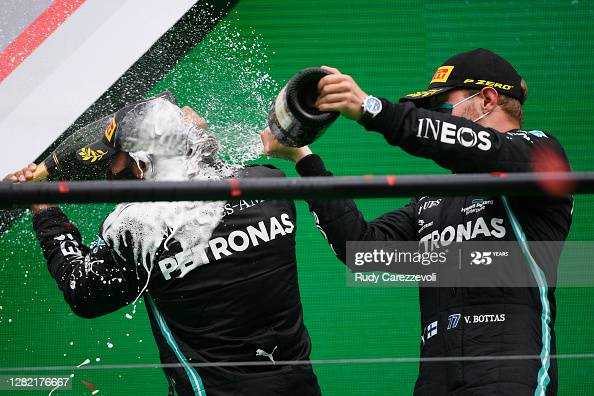 Race winner Lewis Hamilton celebrates his record breaking 92nd race win on the podium with second placed Valtteri Bottas during the F1 Grand Prix of Portugal (Photo credit: Rudy Carezzevoli, Getty Images)