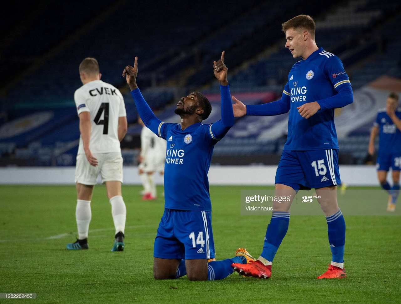 "LEICESTER, ENGLAND - OCTOBER 22: Scorer of Leicester City""u2019s third goal Kelechi Iheanacho drops to his knees after scoring whilst being congratulated by team mate Harvey Barnes during the UEFA Europa League Group G stage match between Leicester City and Zorya Luhansk at The King Power Stadium on October 22, 2020 in Leicester, United Kingdom. (Photo by Visionhaus)"