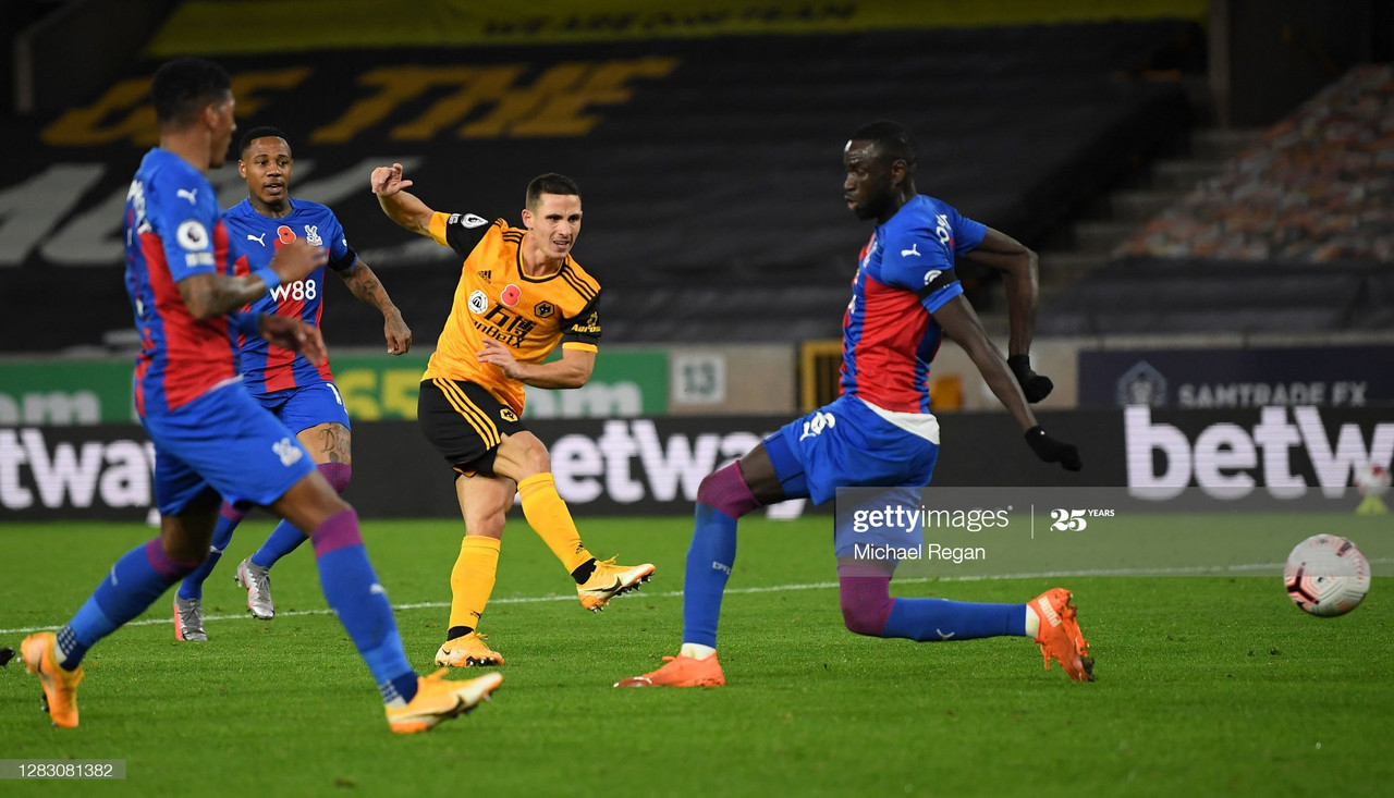 WOLVERHAMPTON, ENGLAND - OCTOBER 30: Daniel Podence of Wolverhampton Wanderers shoots during the Premier League match between Wolverhampton Wanderers and Crystal Palace at Molineux on October 30, 2020 in Wolverhampton, England. Sporting stadiums around the UK remain under strict restrictions due to the Coronavirus Pandemic as Government social distancing laws prohibit fans inside venues resulting in games being played behind closed doors. (Photo by Michael Regan/Getty Images)