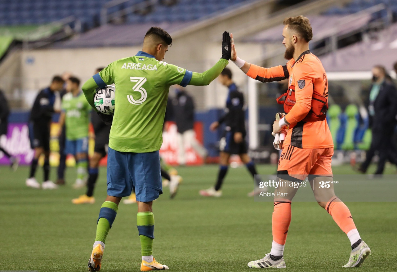 <div>Above:&nbsp;Xavier Arreaga and Stefan Frei high five as the Sounders eased to victory at CenturyLink Field</div><div>(Photo by Abbie Parr/Getty Images)</div>