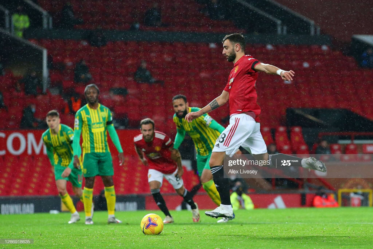MANCHESTER, ENGLAND - NOVEMBER 21: Bruno Fernandes of Manchester United scores his team's first goal, a penalty which he is retaking following a VAR review that decided Sam Johnstone of West Bromwich Albion (not pictured) was off his line, during the Premier League match between Manchester United and West Bromwich Albion at Old Trafford on November 21, 2020 in Manchester, England. Sporting stadiums around the UK remain under strict restrictions due to the Coronavirus Pandemic as Government social distancing laws prohibit fans inside venues resulting in games being played behind closed doors. (Photo by Alex Livesey/Getty Images)