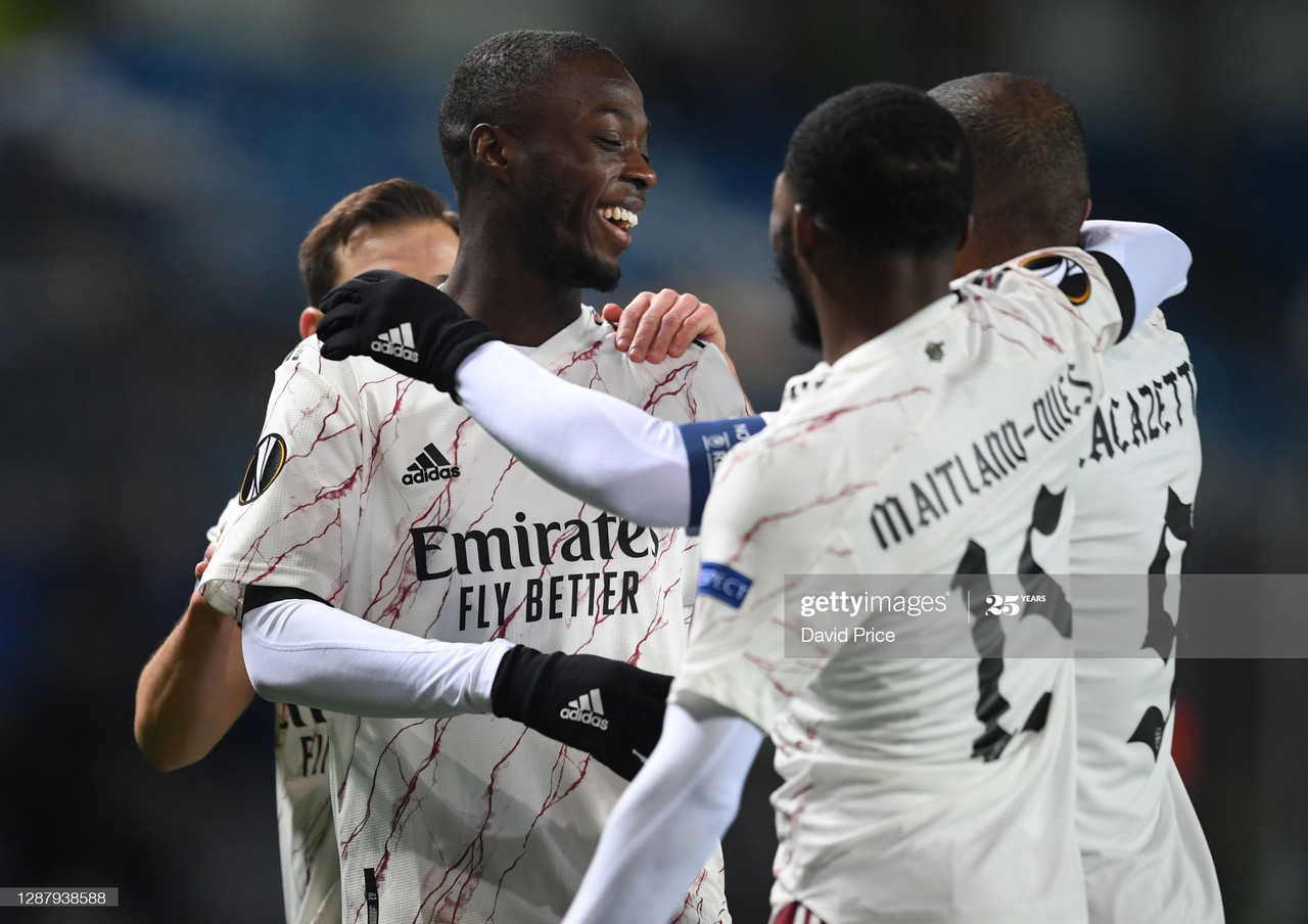 Nicolas Pepe is mobbed by his teammates after scoring the opening goal for the gunners. GettyImages/David Price