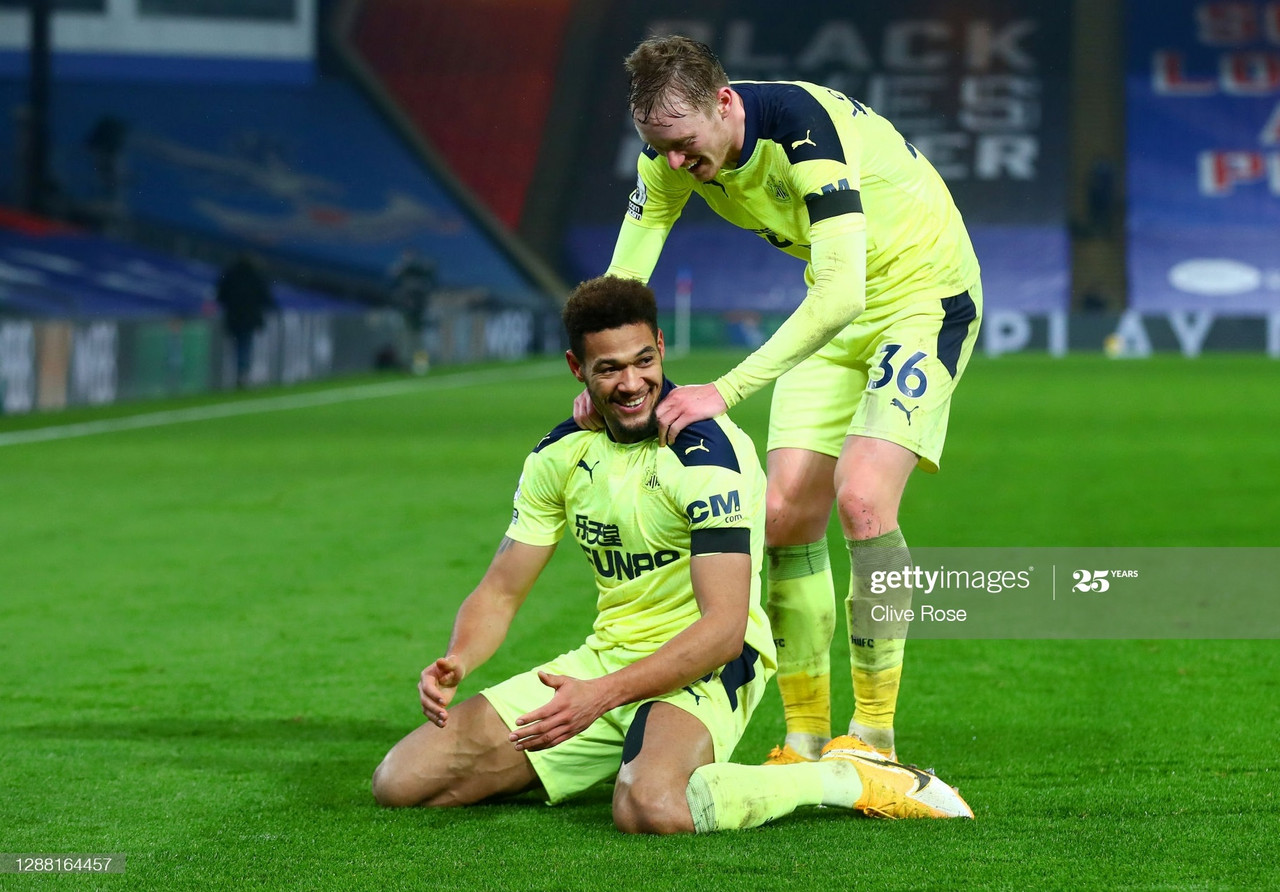 LONDON, ENGLAND - NOVEMBER 27: Joelinton of Newcastle United celebrates with teammate Sean Longstaff after scoring their team's second goal during the Premier League match between Crystal Palace and Newcastle United at Selhurst Park on November 27, 2020 in London, England. Sporting stadiums around the UK remain under strict restrictions due to the Coronavirus Pandemic as Government social distancing laws prohibit fans inside venues resulting in games being played behind closed doors. (Photo by Clive Rose/Getty Images)