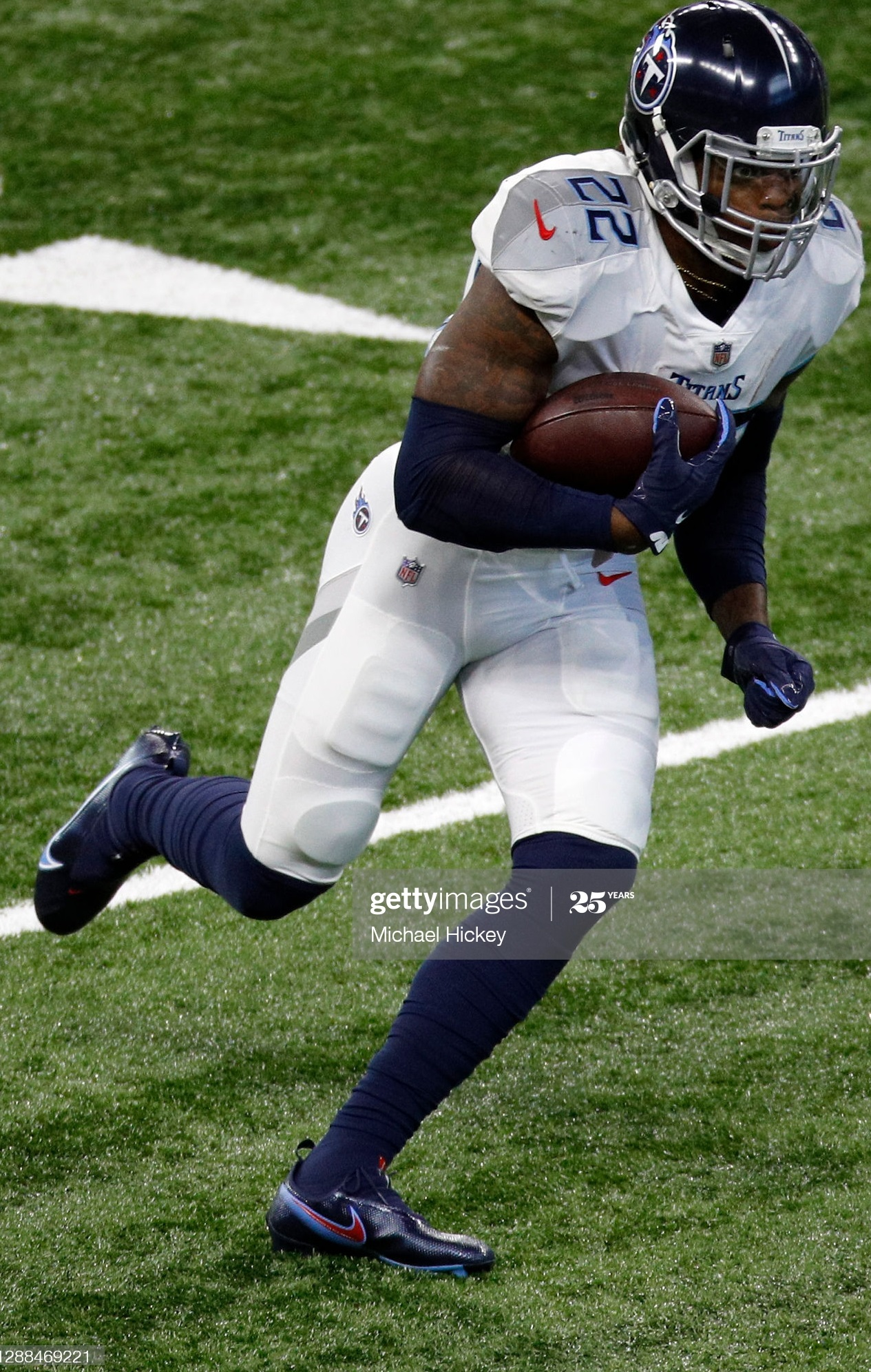 INDIANAPOLIS, INDIANA - NOVEMBER 29: Derrick Henry #22 of the Tennessee Titans carries the ball for extra yardage in the third quarter during their game against the Indianapolis Colts at Lucas Oil Stadium on November 29, 2020 in Indianapolis, Indiana. (Photo by Andy Lyons/Getty Images)