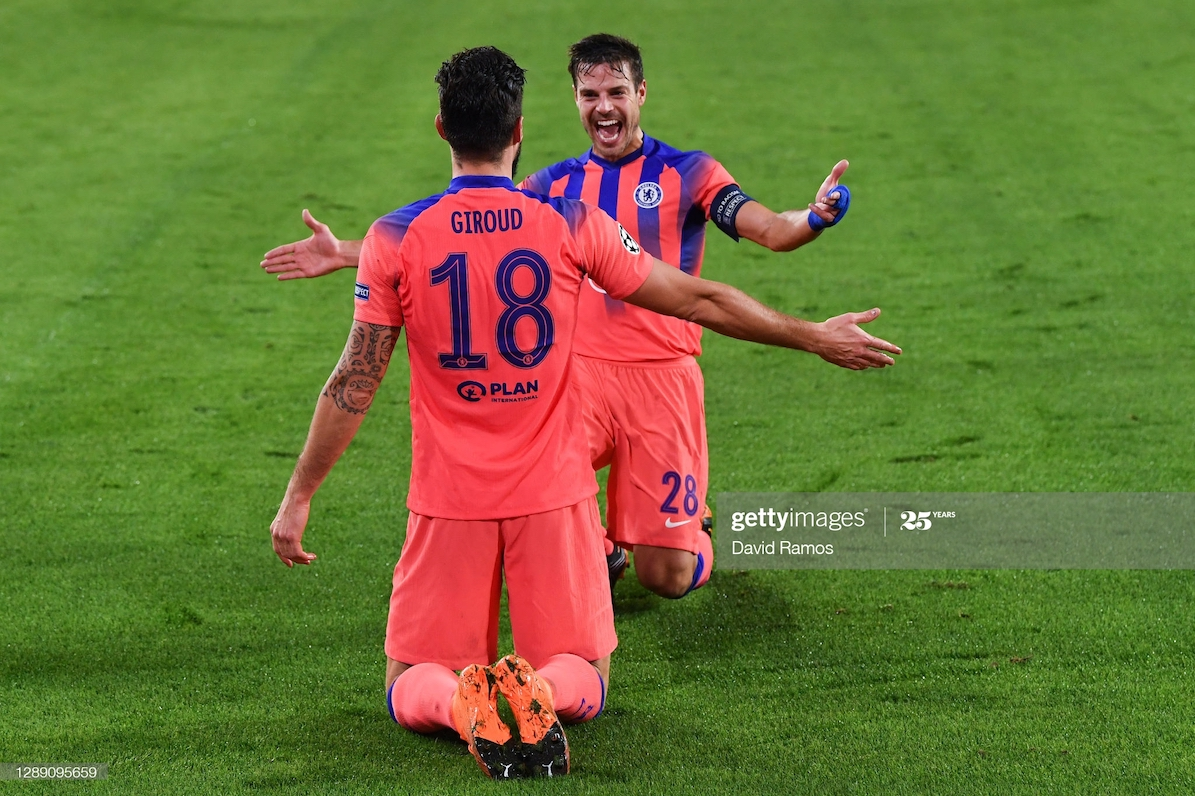 Olivier Giroud of Chelsea celebrates after scoring their sides second goal with Cesar Azpilicueta of Chelsea during the UEFA Champions League Group E stage match between FC Sevilla and Chelsea FC at Estadio Ramon Sanchez Pizjuan on December 02, 2020 in Seville, Spain. (Photo by David Ramos/Getty Images)
