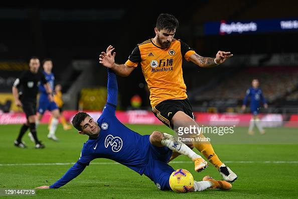 WOLVERHAMPTON, ENGLAND - DECEMBER 15: Christian Pulisic of Chelsea battle for possession with Ruben Neves of Wolves during the Premier League match between Wolverhampton Wanderers and Chelsea at Molineux on December 15, 2020 in Wolverhampton, England. The match will be played without fans, behind closed doors as a Covid-19 precaution. (Photo by Darren Walsh/Chelsea FC via Getty Images)