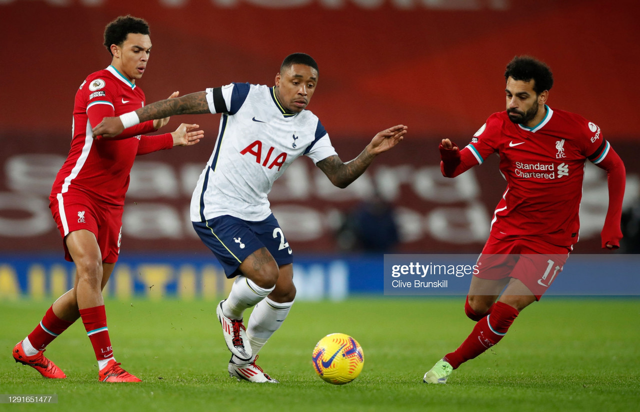 LIVERPOOL, ENGLAND - DECEMBER 16: Steven Bergwijn of Tottenham Hotspur runs with the ball under pressure from Trent Alexander-Arnold and Mohamed Salah of Liverpool during the Premier League match between Liverpool and Tottenham Hotspur at Anfield on December 16, 2020 in Liverpool, England. A limited number of fans (2000) are welcomed back to stadiums to watch elite football across England. This was following easing of restrictions on spectators in tiers one and two areas only. (Photo by Clive Brunskill/Getty Images)