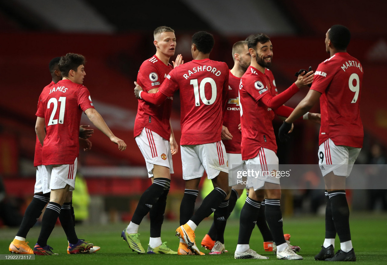 MANCHESTER, ENGLAND - DECEMBER 20: Scott McTominay of Manchester United celebrates with team mates (l - r) Marcus Rashford, Bruno Fernandes and Anthony Martial after scoring their sides first goal during the Premier League match between Manchester United and Leeds United at Old Trafford on December 20, 2020 in Manchester, England. The match will be played without fans, behind closed doors as a Covid-19 precaution. (Photo by Nick Potts - Pool/Getty Images)