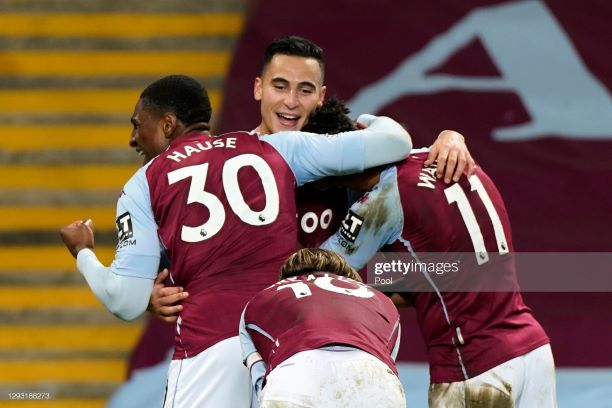 BIRMINGHAM, ENGLAND - DECEMBER 26: Anwar El Ghazi of Aston Villa celebrates with teammates Kortney Hause, Ollie Watkins and Jack Grealish after scoring his team's third goal during the Premier League match between Aston Villa and Crystal Palace at Villa Park on December 26, 2020 in Birmingham, England. The match will be played without fans, behind closed doors as a Covid-19 precaution. (Photo by Tim Keeton - Pool/Getty Images)