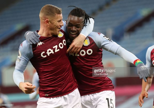 BIRMINGHAM, ENGLAND - JANUARY 23: Bertrand Traore of Aston Villa celebrates with teammate Ross Barkley (L) after scoring their team's second goal during the Premier League match between Aston Villa and Newcastle United at Villa Park on January 23, 2021 in Birmingham, England. Sporting stadiums around England remain under strict restrictions due to the Coronavirus Pandemic as Government social distancing laws prohibit fans inside venues resulting in games being played behind closed doors. (Photo by Clive Brunskill/Getty Images)