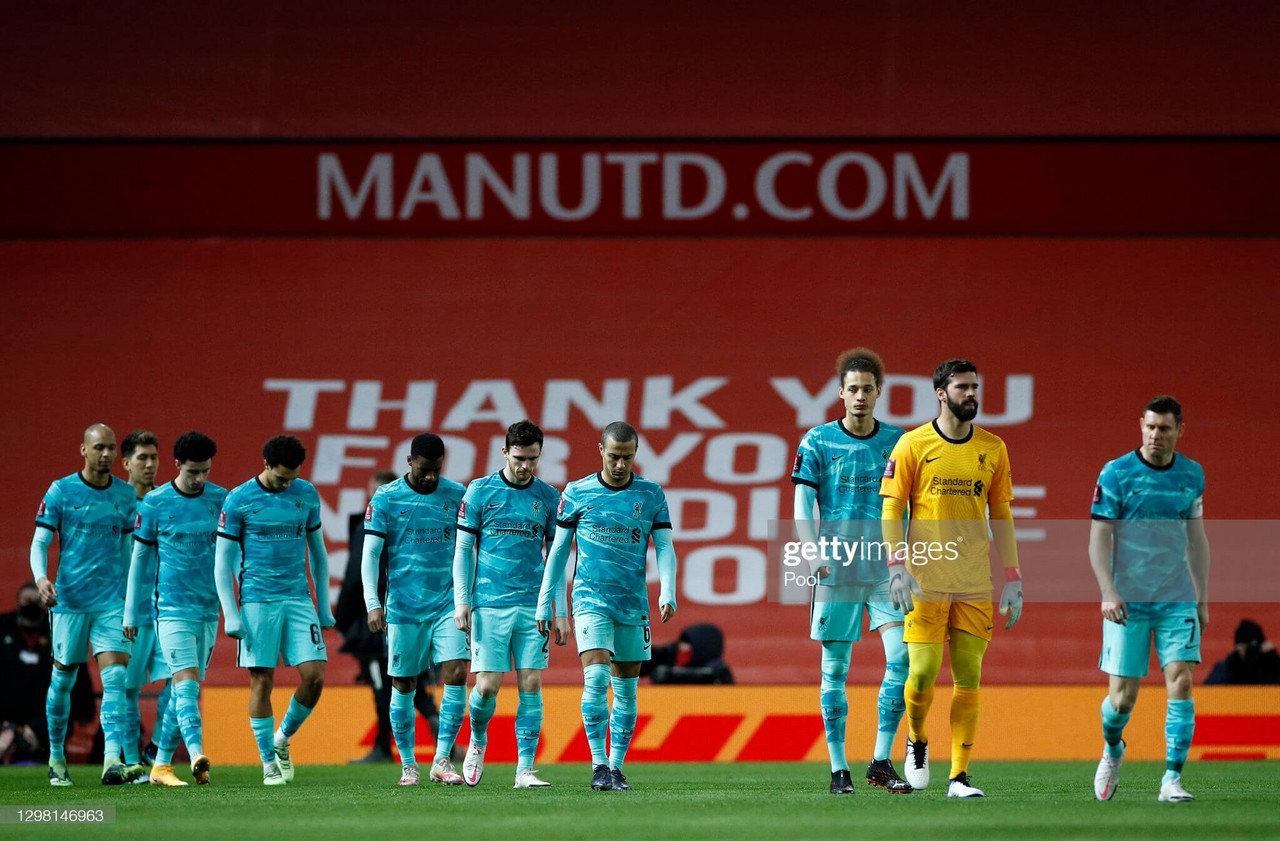 MANCHESTER, ENGLAND - JANUARY 24: James Milner (R) of Liverpool leads his team out on to the pitch ahead of The Emirates FA Cup Fourth Round match between Manchester United and Liverpool at Old Trafford on January 24, 2021 in Manchester, England. Sporting stadiums around the UK remain under strict restrictions due to the Coronavirus Pandemic as Government social distancing laws prohibit fans inside venues resulting in games being played behind closed doors. (Photo by Phil Noble - Pool/Getty Images)
