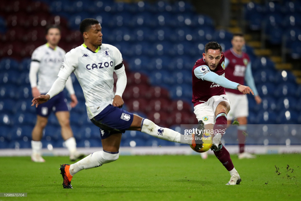 BURNLEY, ENGLAND - JANUARY 27: Josh Brownhill of Burnley has a shot blocked by Ezri Konsa of Aston Villa during the Premier League match between Burnley and Aston Villa at Turf Moor on January 27, 2021 in Burnley, England. Sporting stadiums around the UK remain under strict restrictions due to the Coronavirus Pandemic as Government social distancing laws prohibit fans inside venues resulting in games being played behind closed doors. (Photo by Clive Brunskill/Getty Images)