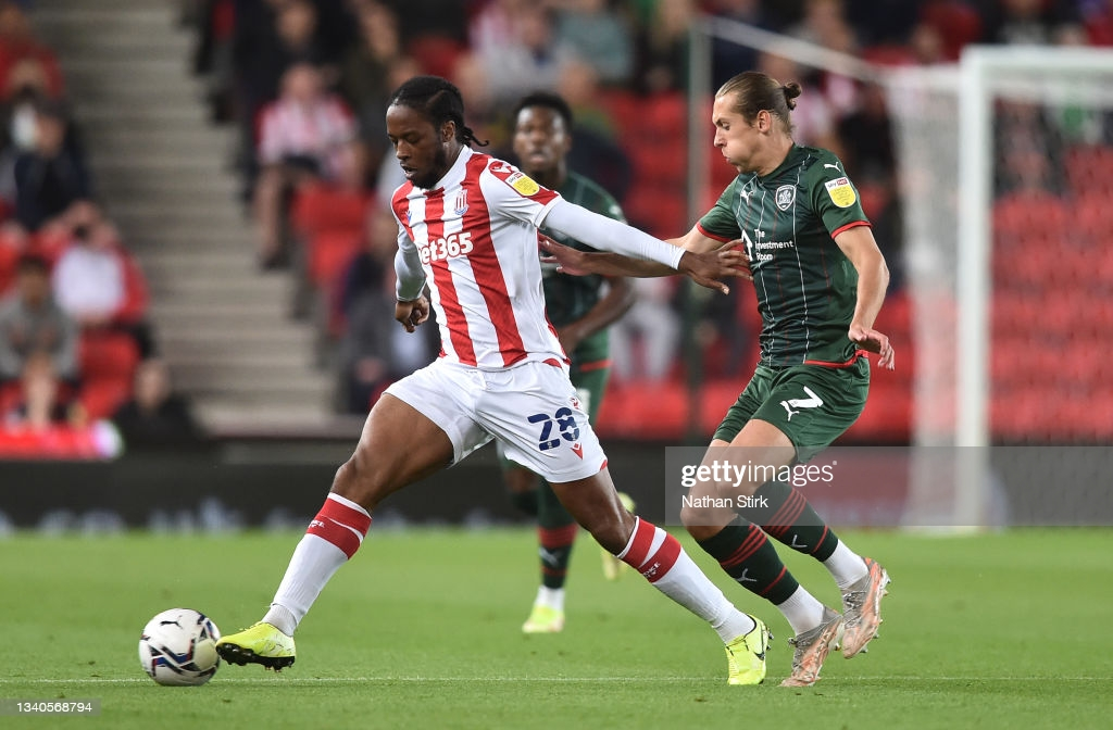Stoke City 1-1 Barnsley: Collins spares Tykes' blushes in eventful draw