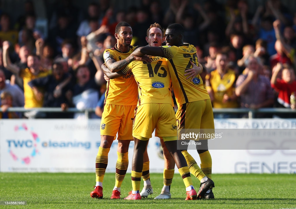 Sutton United 4-3 Port Vale: Yellow Army into play-off places after Rowe stoppage time winner
