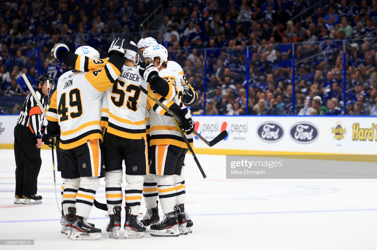Shorthanded Penguins rout two-time defending champion Lightning on opening night