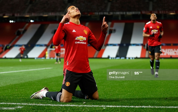 <div>MANCHESTER, ENGLAND - OCTOBER 28: Mason Greenwood of Manchester United celebrates after scoring his sides first goal during the UEFA Champions League Group H stage match between Manchester United and RB Leipzig at Old Trafford on October 28, 2020 in Manchester, England. Sporting stadiums around the UK remain under strict restrictions due to the Coronavirus Pandemic as Government social distancing laws prohibit fans inside venues resulting in games being played behind closed doors. (Photo by Clive Brunskill/Getty Images)</div>