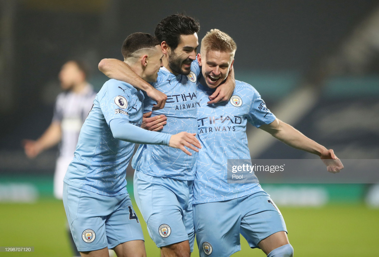 Ilkay Guendogan of Manchester City celebrates with Oleksandr Zinchenko (R) and Phil Foden (L)after scoring their team's first goal during the Premier League match between West Bromwich Albion and Manchester City at The Hawthorns. (Photo by Nick Potts - Pool/Getty Images)