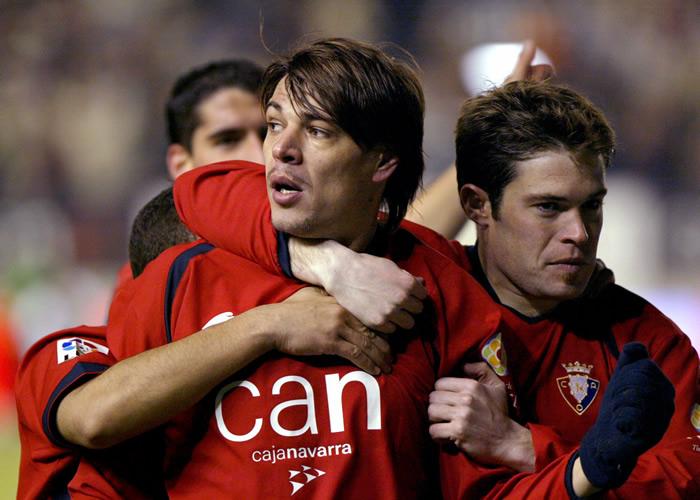 Milosevic celebra un gol con Iñaki Muñoz. Fotografía: As.