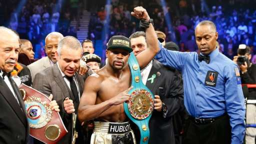Victorious: Mayweather stands tall