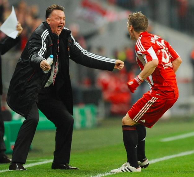 Re-united again: Schweinsteiger celebrates with Van Gaal